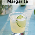 Pinterest Pin with text overlay 'Classic Margarita', image of salt rimmed glass with margarita garnished with a lime wheel.
